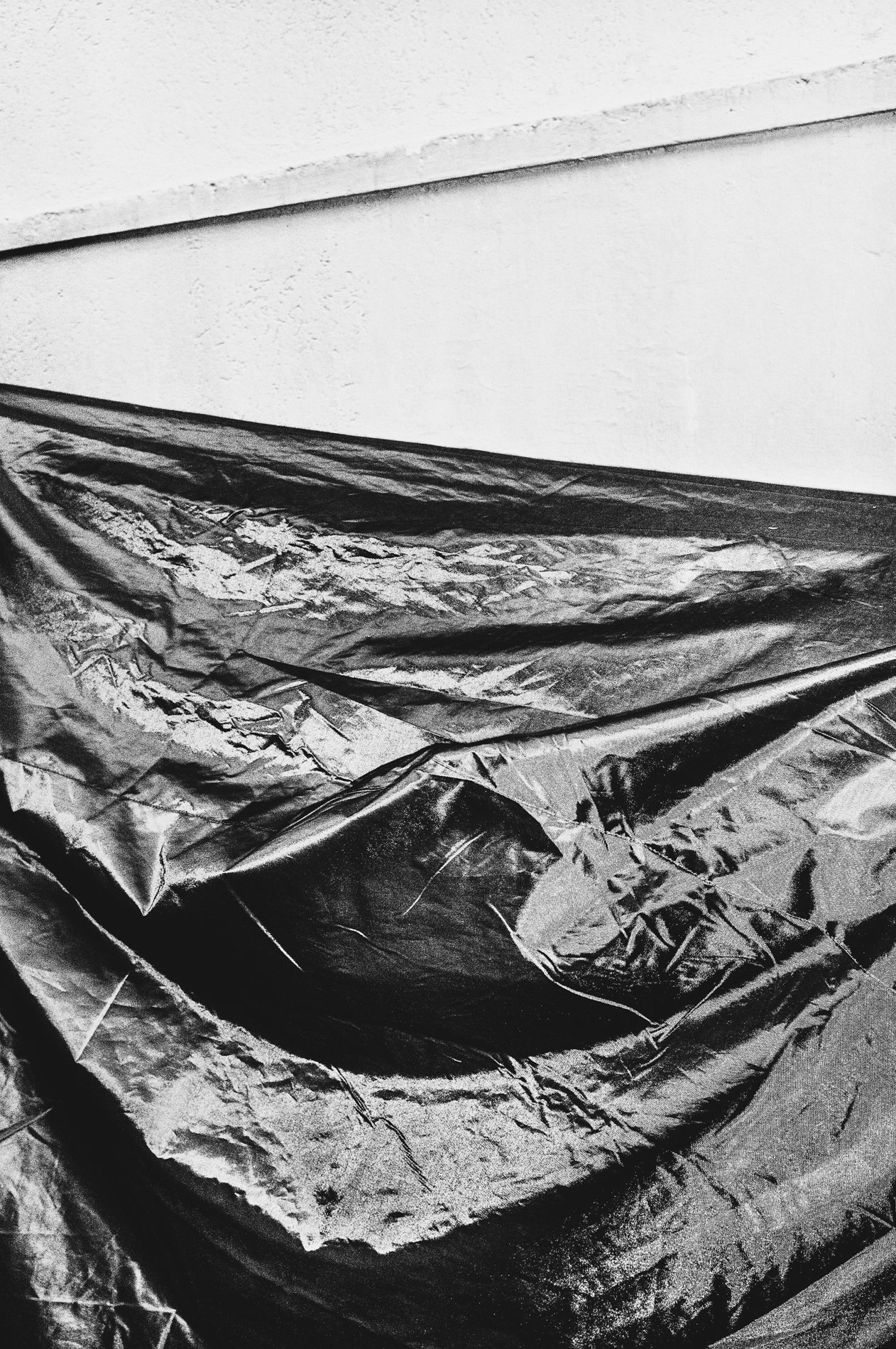 plastic tarp black and white photography with high contrast and flash by francesco merlini