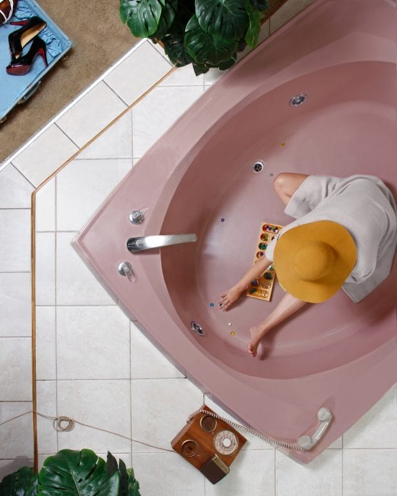 woman in bathtub color photography of patterns from above by Hayley Eichenbaum and Zach Swearingen