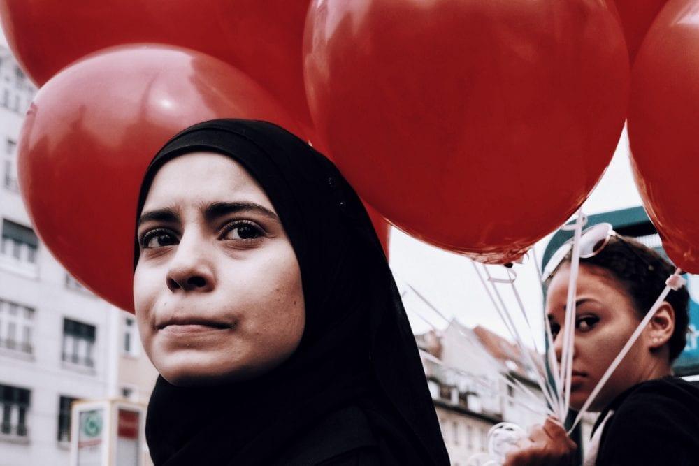 portrait of a woman, street photography of a person, by efi logginou
