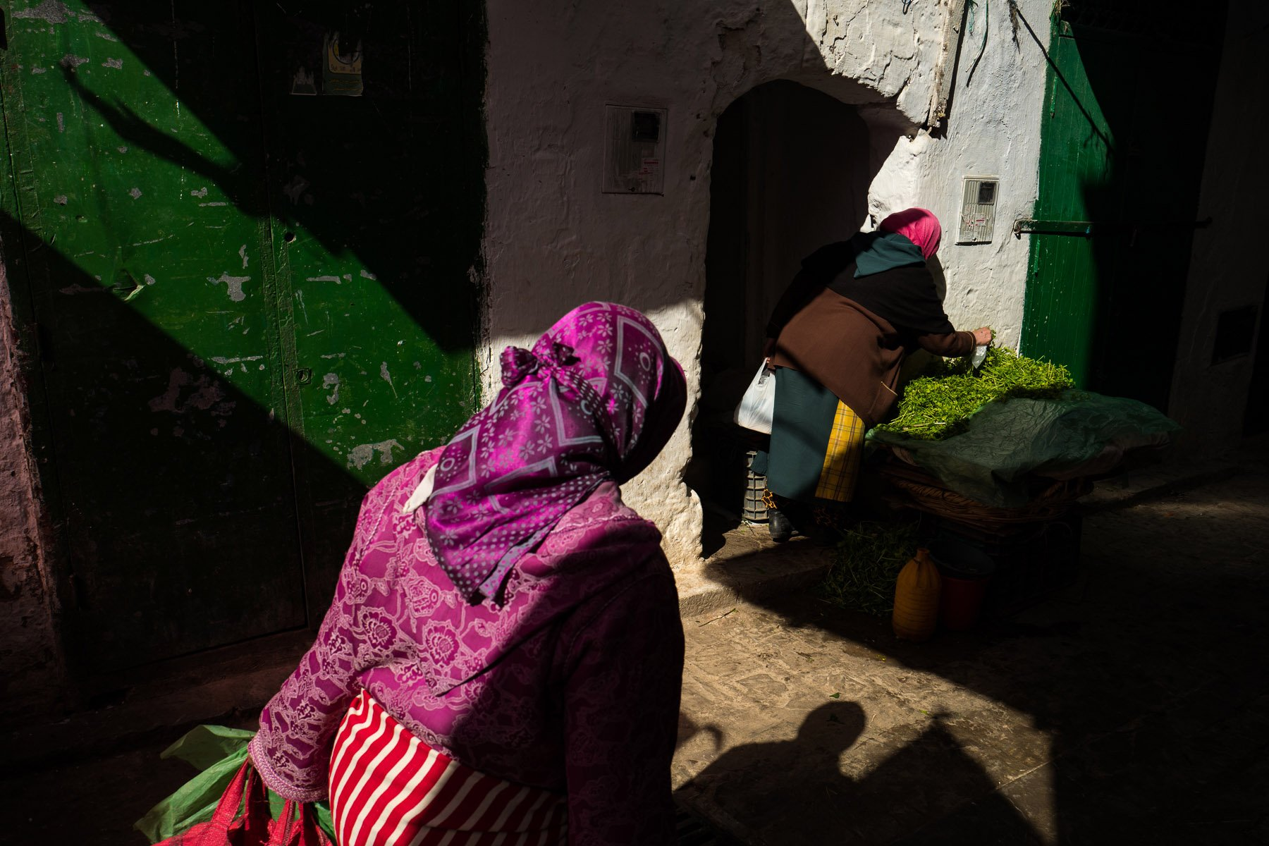 street photography, colorful images with high contrast and shadows in Morocco, Africa, by ivan Margot