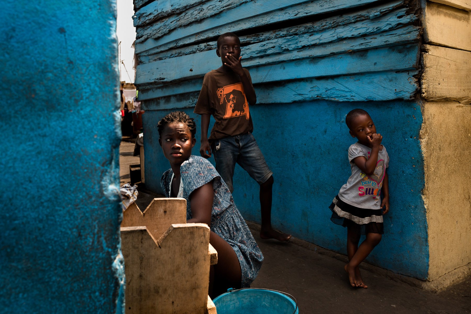 street photography, colorful images with high contrast and shadows in Ghana, Africa, by ivan Margot