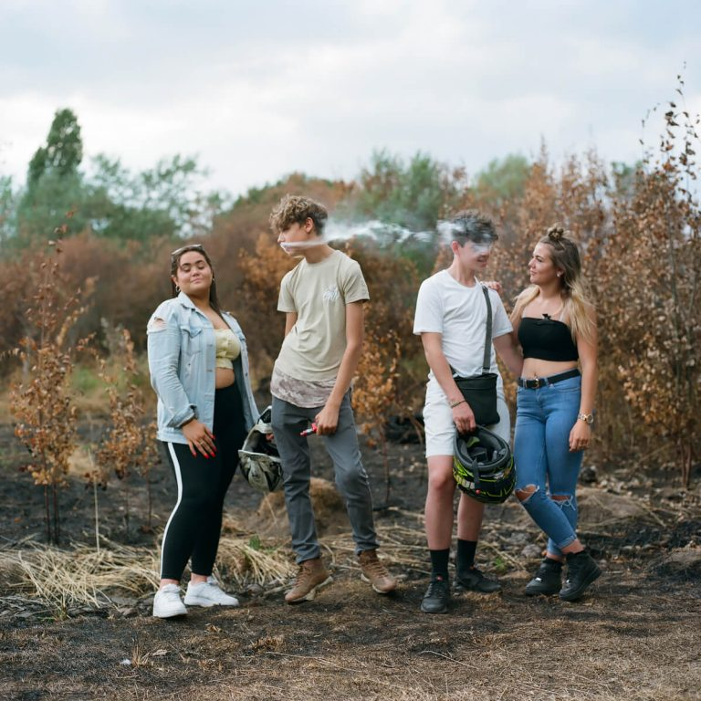 Color film photography by Laura Pannack, teenagers smoking