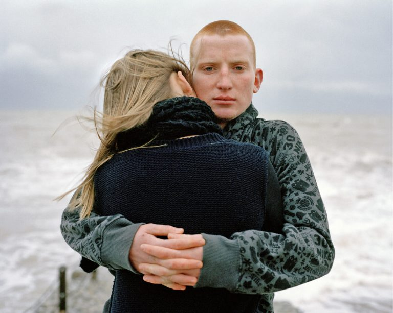 Color film photography by Laura Pannack, young couple, teens, sea