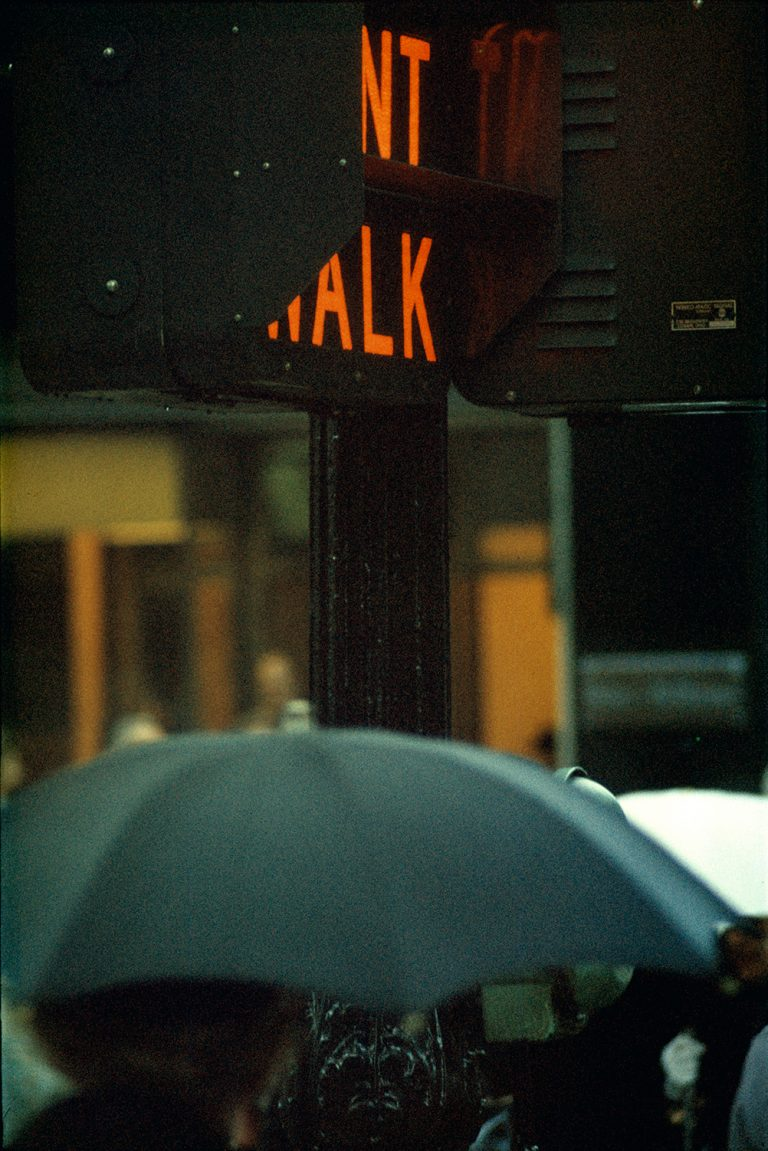 Color photo by Saul Leiter, umbrella, Traffic lights, NYC
