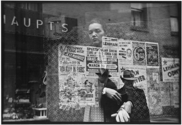 Black and white photo by Saul Leiter, woman looking through window, posters, reflections
