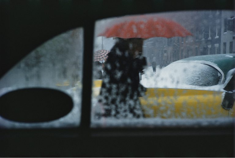 Color photo by Saul Leiter, red umbrella, snow, window, NYC