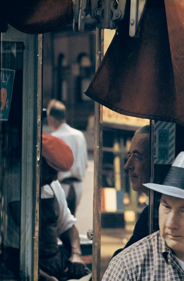 Color photo by Saul Leiter, men, shoe shiner, reflections, NYC