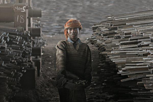 Color portrait photograph of a boy working in a shipyard in Dhaka, Bangladesh - Visual Storytelling Award