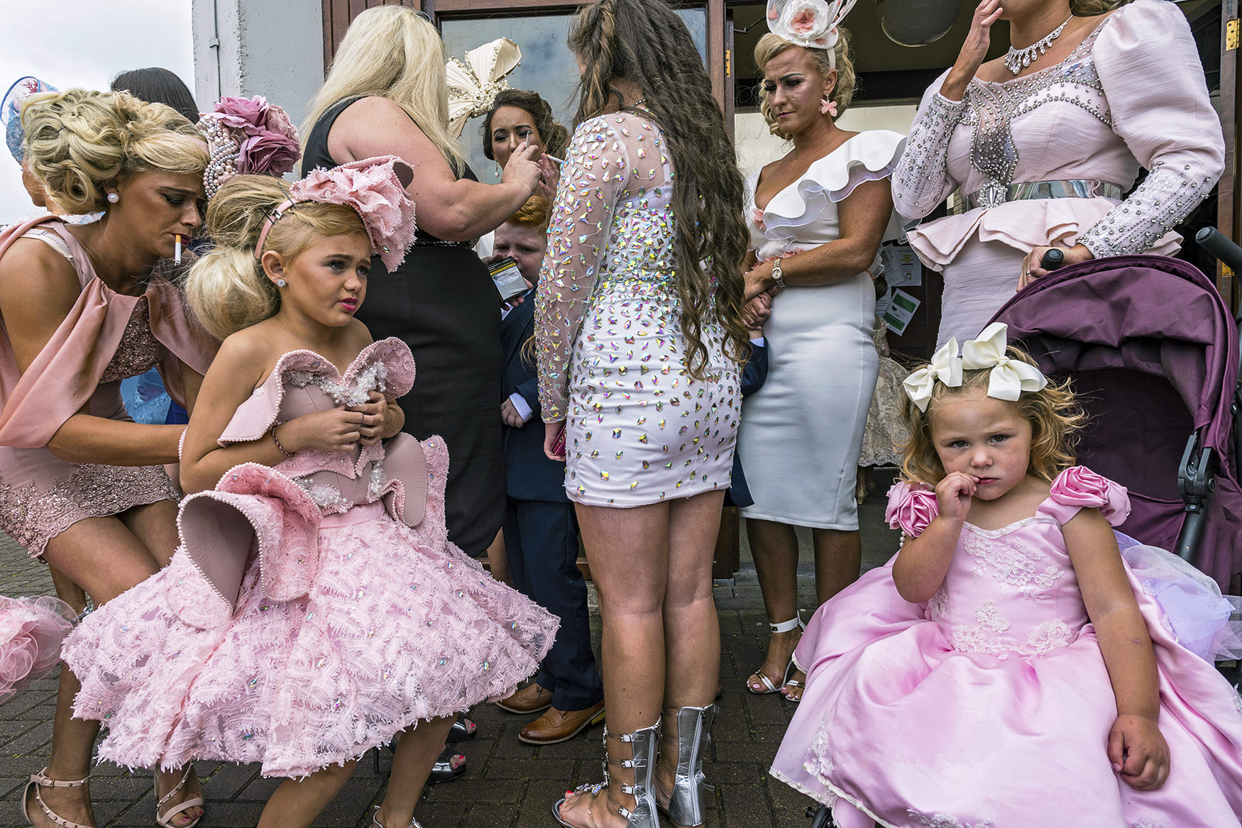 street color photograph of women at a wedding shot in Wexford, Ireland by Joseph-Philippe Bevillard