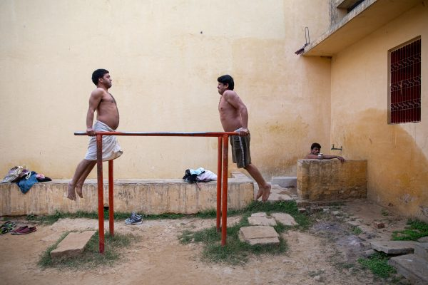 street color photograph of men working out in Varanasi, India 2020 by Susanne Grether