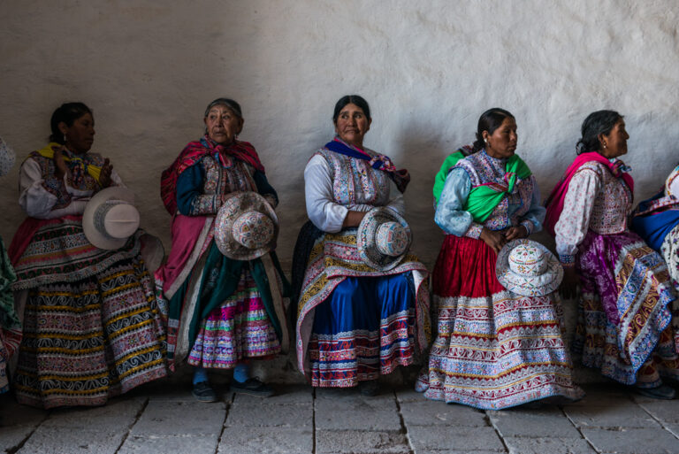 Color photo by Luis Fabini from the series Harvest. Group portrait, indigenous woman, Andes Mountains, Peru