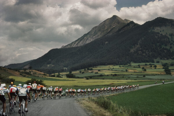 Harry Gruyaert -Tour de France, 1982 Into the valley before the big Alpine mountains. At the back wearing the tricolour jersey is the French Champion Régis Clère. France. 1982.